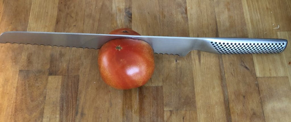 A Global serrated tomato knife. Rated for being the Best tomato knife.