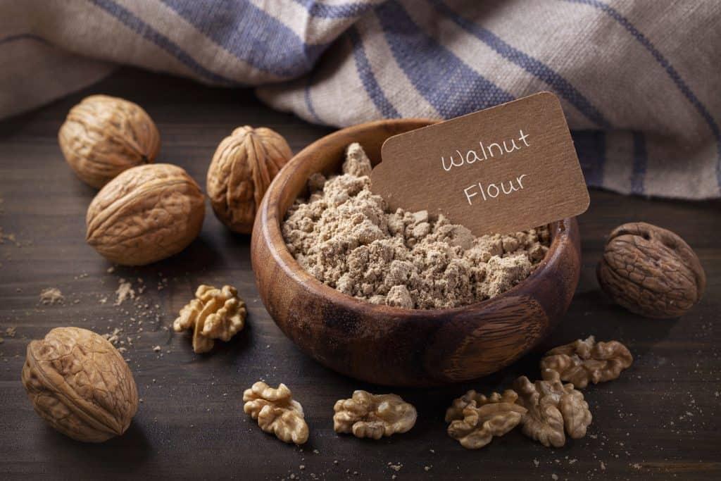 walnut flour ground up in a wooden bowl